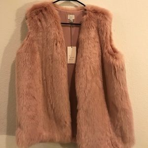 Pink Fux fur vest never been worn.